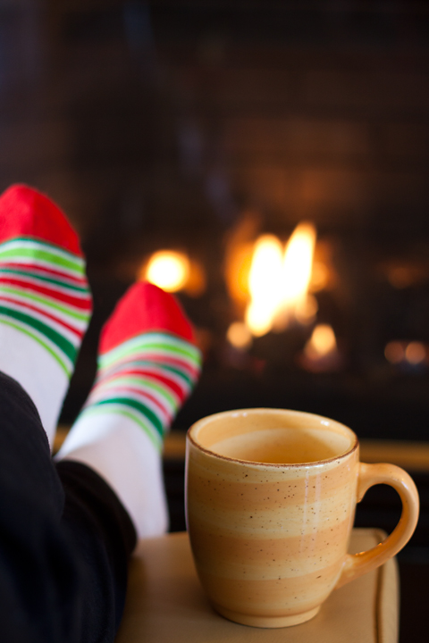 fireplace fireside chat with mug of hot cider coffee or tea